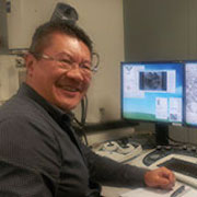 Colour portrait photograph of Peter Chung, microanalyst and TAHG member at the University of Glasgow