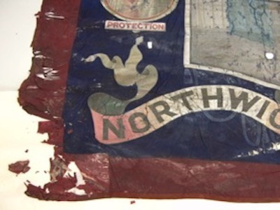 Colour photograph showing a corner region of a trade union banner made as painted textile