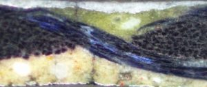 Colour image showing a microscopy scan of a cross-section of a painted textile banner