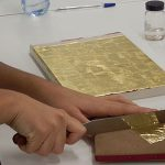Gilding work is one stage during the estofado process