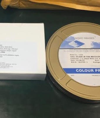 Colour photograph showing a selection of film canisters that house 16mm film-based works within the collection of National Galleries of Scotland, Edinburgh