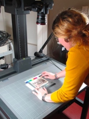 Colour photograph of a student photographing prints for a study into photographic processes (courtesy of Carrie Henrichs)