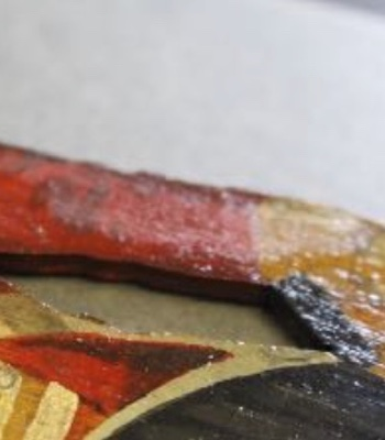Detail showing uneven varnish surface on arm area from a painted wooden soldier (courtesy of the Royal Highland Fusiliers Museum)