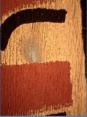 Magnified image of a detail from a painted banner for the Coronation of King George VI, Glasgow Museums showing copper corrosion and hand- painted finishing details in black (© CSG CIC Glasgow Museums and Library Collections)