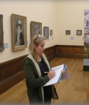 Colour photograph showing a researcher at work recording details of paintings in the Scottish Colourists' Room at Kelvingrove (copyright Ruth Wright)